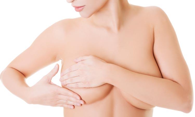 sintomas de tener quistes en los senos